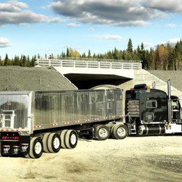 Gray trailer filled with gravel
